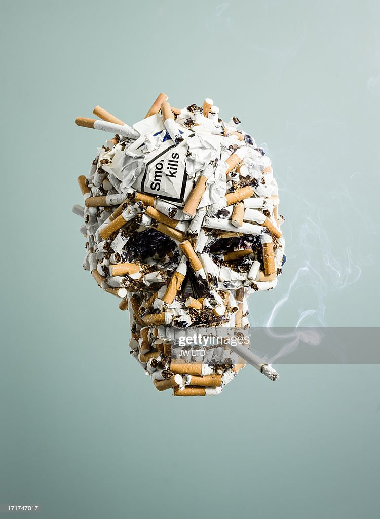 Skull made from cigarettes , smoking : Stock Photo