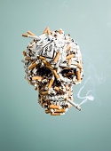 Skull made from cigarettes , smoking