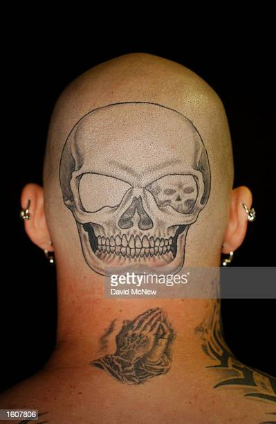 A skull tattoo is a work in progress that will eventually cover the head of tattoo artist Jim Antosh of Burlington WI during the 61st annual Sturgis...