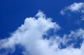 Blue sky background with white clouds on sunny day