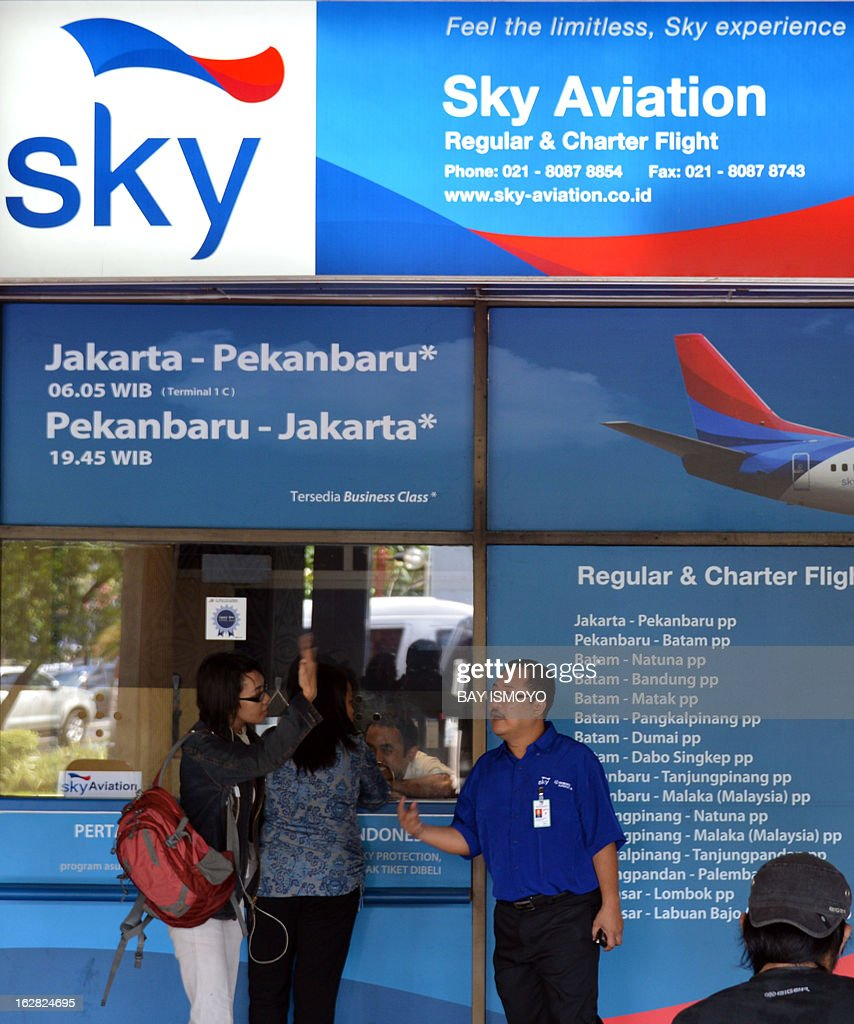 Sky aviation ticket counter provides nformations and tickets to passengers at Halim airport in Jakarta on February 28, 2013 as the airline launched its new aircraft Sukhoi Superjet 100 on its fleet. Indonesia has certified Russian-made Sukhoi civilian jets as airworthy, allowing the export of the planes to the booming aviation market despite a pending probe into a crash that killed all 45 onboard. AFP PHOTO / Bay ISMOYO