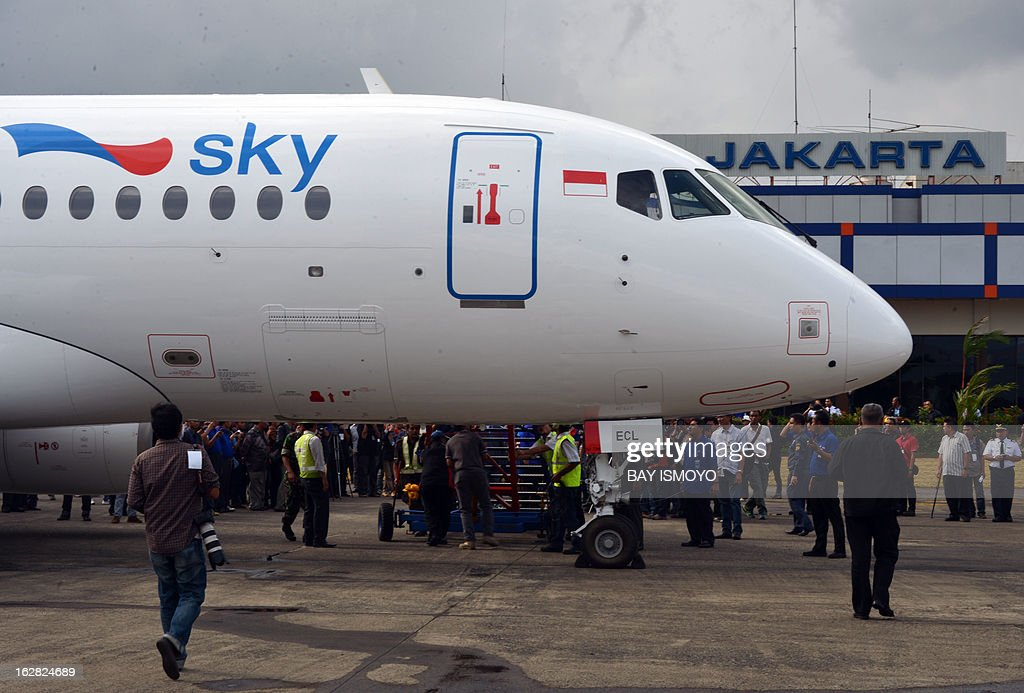 A Sky aviation's new aircraft, the Sukhoi Superjet 100, arrives at the launching ceremony at Halim airport in Jakarta on February 28, 2013. Indonesia has certified Russian-made Sukhoi civilian jets as airworthy, allowing the export of the planes to the booming aviation market despite a pending probe into a crash that killed all 45 onboard. AFP PHOTO / Bay ISMOYO