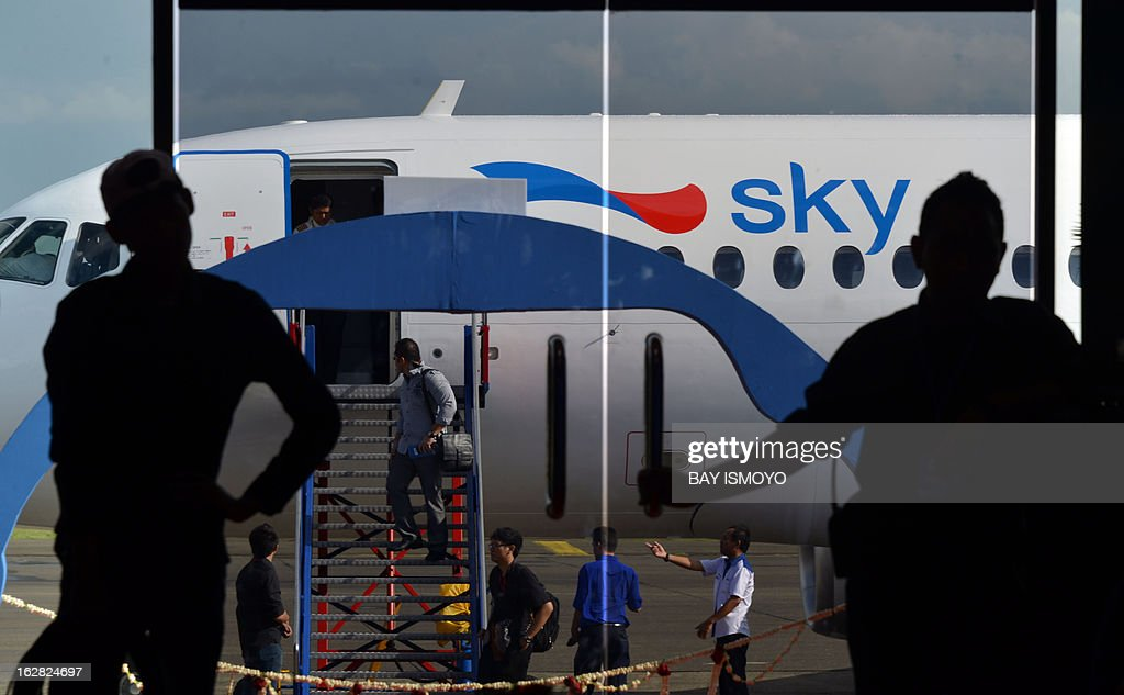 A Sky aviation's new aircraft, the Sukhoi Superjet 100, is parked for the launching ceremony at Halim airport in Jakarta on February 28, 2013. Indonesia has certified Russian-made Sukhoi civilian jets as airworthy, allowing the export of the planes to the booming aviation market despite a pending probe into a crash that killed all 45 onboard. AFP PHOTO / Bay ISMOYO