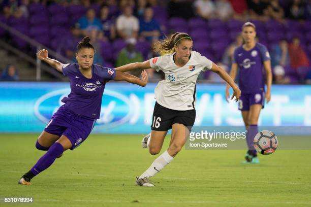 Sky Blue FC midfielder Sarah Killion and Orlando Pride defender Camila Pereira chase the ball during the NWSL soccer match between the Orlando Pride...