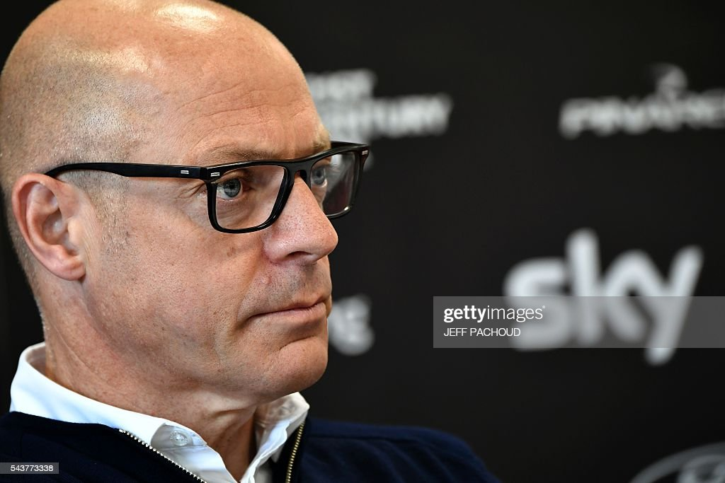 Sky cycling team manager Sir Dave Brailsford takes part in a press conference of the Sky cycling team at his hotel in Port-en-Bessin-Huppain, Normandy, on July 30, 2016, two days before the start of the 103rd edition of the Tour de France cycling race. The 2016 Tour de France will start on July 2 in the streets of Le Mont-Saint-Michel and ends on July 24, 2016 down the Champs-Elysees in Paris. The 2016 Tour de France will start on July 2 in the streets of Le Mont-Saint-Michel and ends on July 24, 2016 down the Champs-Elysees in Paris. / AFP / jeff pachoud
