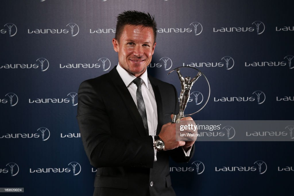 Sky Diver Felix Baumgartner poses with the award for Laureus World Action Sportsperson of the Year in the winners studio during the 2013 Laureus...