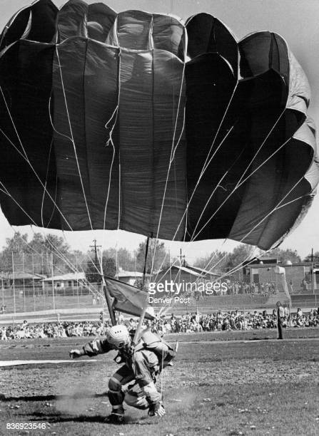 Sky Divers Stage Show Bernie Roland his rainbowstriped parachute setting him down without mishap lands in front of an audience of more than 400...
