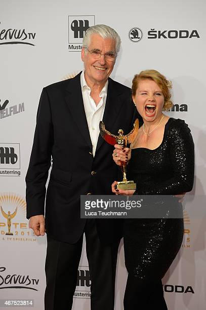 Sky du Mont and Annette Frier poses with her prize during the Jupiter Award at Cafe Moskau on March 25 2015 in Berlin Germany