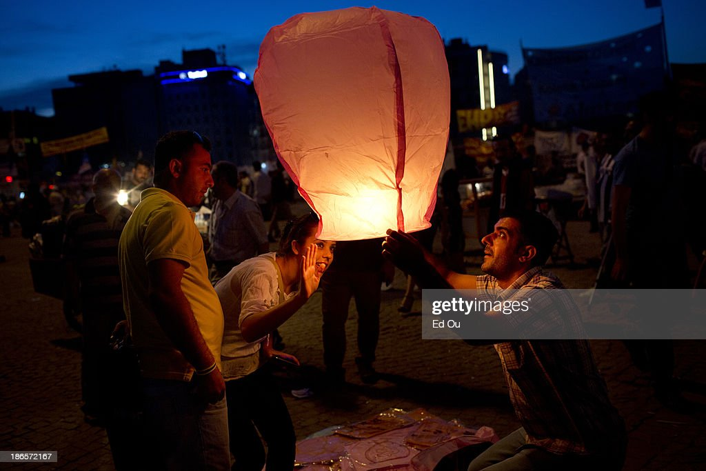 Sky lanterns are released into the air in Taksim Square in Istanbul Turkey on June 10 2013 What started out as a protest over the demolition of a...