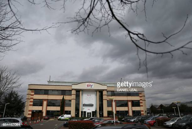 A Sky logo is pictured on a sign above the entrnce to payTV giant Sky Plc's headquarters in Isleworth west London on March 17 2017 A proposed...