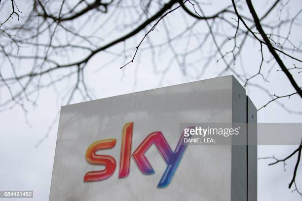 A Sky logo is pictured on a sign next to the entrance to payTV giant Sky Plc's headquarters in Isleworth west London on March 17 2017 A proposed...