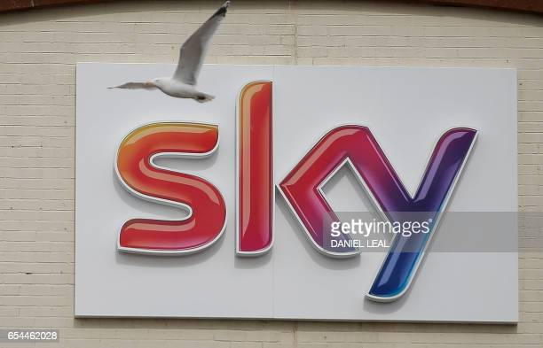 A Sky logo is pictured outside payTV giant Sky Plc's headquarters in Isleworth west London on March 17 2017 A proposed multibillion takeover bid for...