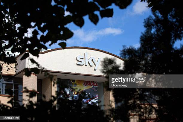 A Sky logo sits above the entrance to British Sky Broadcasting Group Plc's headquarters in London UK on Friday Oct 4 2013 BSkyB will focus on...