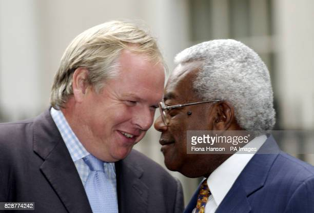 Sky News Adam Boulton and ITN's Sir Trevor McDonald outside Downing Street in London on the day that Alaistair Campbell resigned