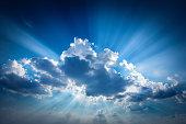The sun's rays make their way through the cloud