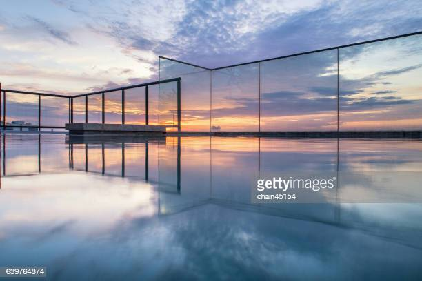 Sky pool and sky bar in the city during sunset.