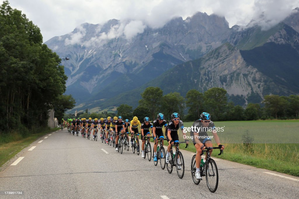 Sky Procycling drive the peloton as they defend the overall race leader's jersey for <a gi-track='captionPersonalityLinkClicked' href=/galleries/search?phrase=Chris+Froome&family=editorial&specificpeople=5428054 ng-click='$event.stopPropagation()'>Chris Froome</a> of Great Britain riding for Sky Procycling during stage eighteen of the 2013 Tour de France, a 172.5KM road stage from Gap to l'Alpe d'Huez, on July 18, 2013 in Chauffayer, France.