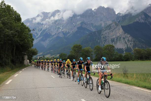 Sky Procycling drive the peloton as they defend the overall race leader's jersey for Chris Froome of Great Britain riding for Sky Procycling during...