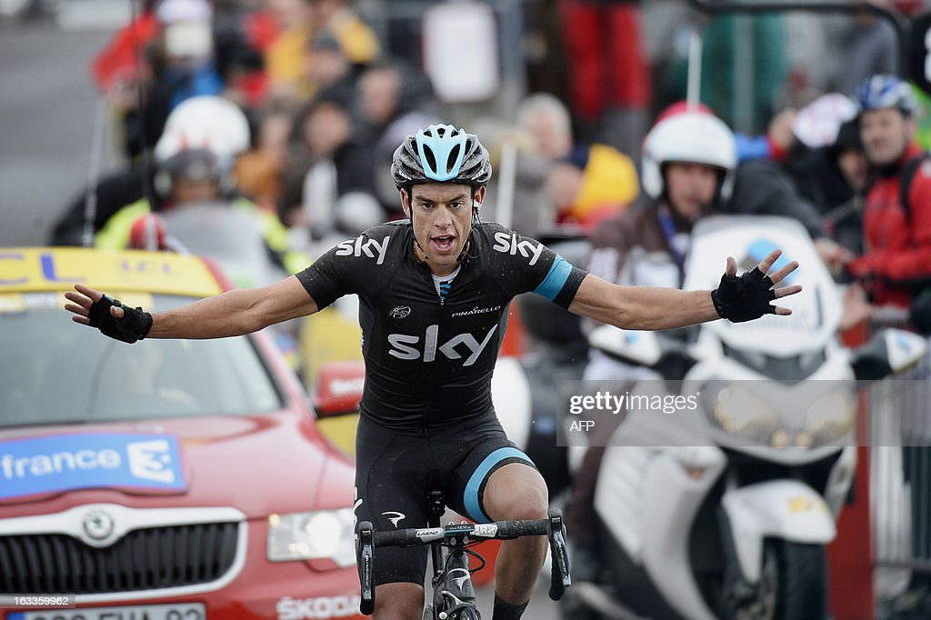Sky Procycling Team Australian cyclist Richie Porte crosses the finish line and wins the fifth stage of the 71st Paris-Nice cycling race between Chateauneuf du Pape and La Montagne de Lure, on March 8, 2013. AFP PHOTO / JEFF PACHOUD