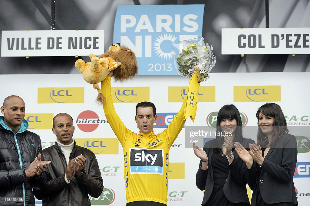Sky Procylcing Team Australian cyclist Richie Porte (C) celebrates with his overall leader yellow jersey on the podium of the seventh and last stage (time trial) of the 71st Paris-Nice cycling race in Nice, on March 10, 2013. Porte won the Paris-Nice.