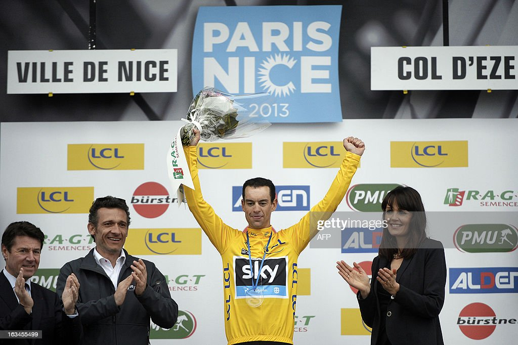 Sky Procylcing Team Australian cyclist Richie Porte celebrates with his overall leader yellow jersey on the podium of the seventh and last stage (time trial) of the 71st Paris-Nice cycling race in Nice, on March 10, 2013. Porte won the Paris-Nice.