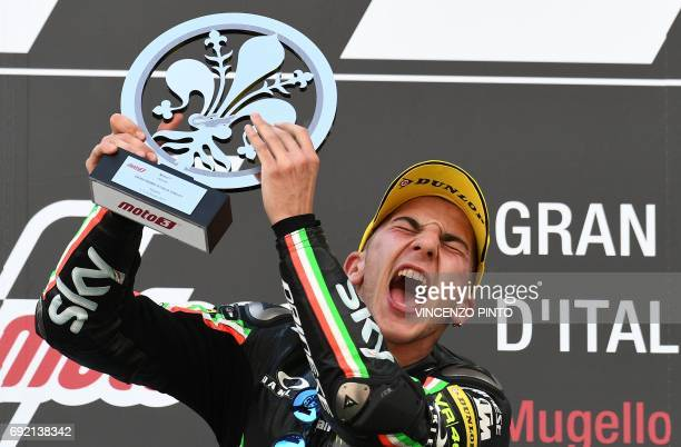 Sky Racing Team VR46 rider Italian Andrea Migno celebrates on the podium after winning the Moto 3 Grand Prix at the Mugello race track on June 4 2017...