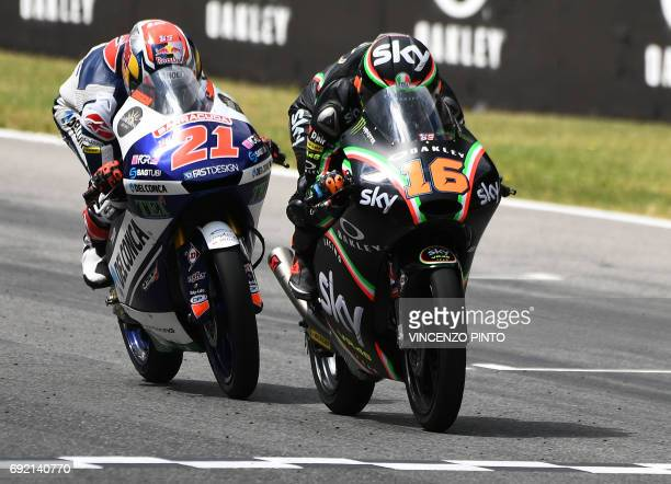 Sky Racing Team VR46 rider Italian Andrea Migno competes with Del Conca Gresini rider Italian Fabio Di Giannantonio during the Moto3 Grand Prix at...