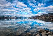 Sky reflected in Okanagan Lake, Naramata, British Columbia, Canada