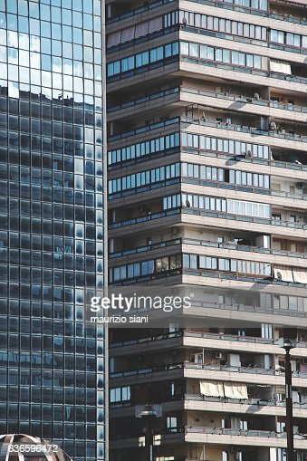 Sky reflected in windows of modern office building and residential condominium building in 'Office District in Naples' ('Centro Direzionale in Naples')