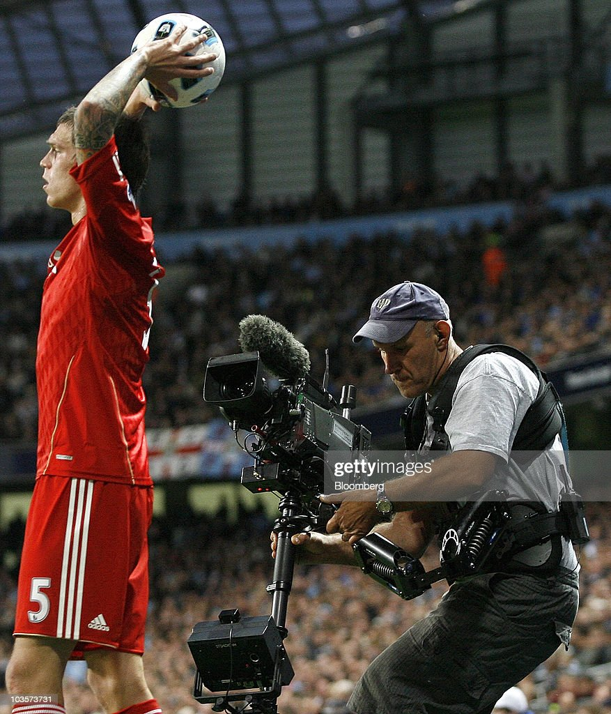 A Sky Sports camera operator, right, films during Sky's television coverage of the soccer match between Manchester City and Liverpool, at the City of Manchester stadium in Manchester, U.K., on Monday, Aug. 23, 2010. British Sky Broadcasting Group Plc, which rejected News Corp.'s proposed bid for full ownership last month, said annual adjusted operating profit rose 10 percent as more clients signed up for high-definition television service. Photographer: Simon Bellis/Bloomberg via Getty Images