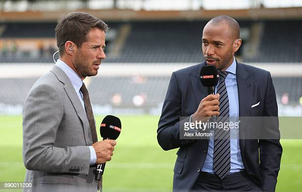 Sky Sports presenters Thierry Henry and Jamie Redknapp during the Premier League match between Hull City and Leicester City at KC Stadium on August...