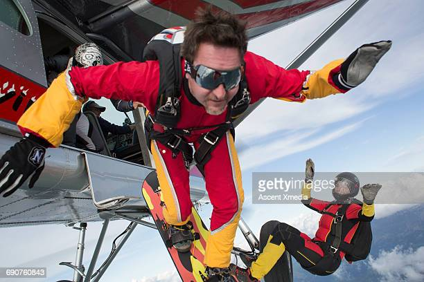 Sky surfer in freefall from fixed wing plane