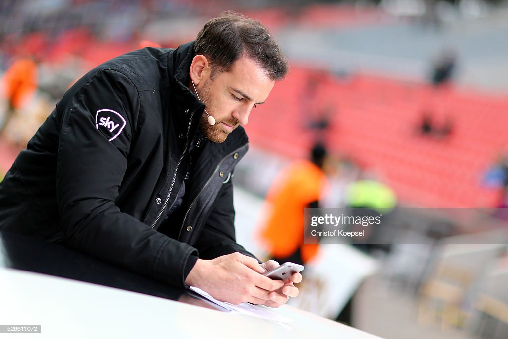 Sky television expert Christoph metzeldr is seen prior to the Bundesliga match between Bayer Leverkusen and Hertha BSC Berlin at BayArena on April 30, 2016 in Leverkusen, Germany. The match between Leverkusen and Berlin ended 2-1.
