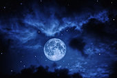 Night sky with clouds stars and full moon