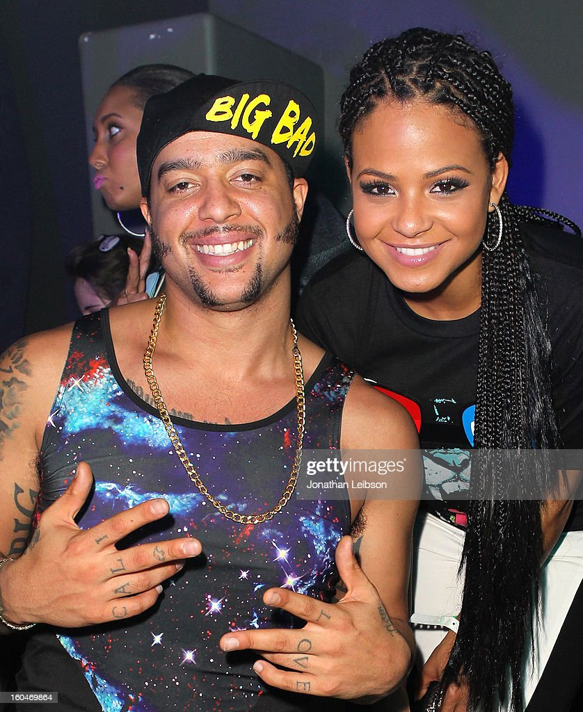 SkyBlu and Christina Milian pose at the SkyBlu 'Pop Bottles' Single Release Party at Lure on January 31, 2013 in Hollywood, California.