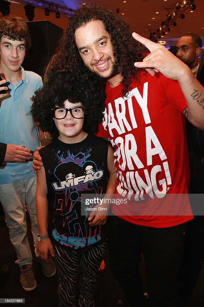 SkyBlu of <a gi-track='captionPersonalityLinkClicked' href=/galleries/search?phrase=LMFAO&family=editorial&specificpeople=5419624 ng-click='$event.stopPropagation()'>LMFAO</a> (R) poses with an <a gi-track='captionPersonalityLinkClicked' href=/galleries/search?phrase=LMFAO&family=editorial&specificpeople=5419624 ng-click='$event.stopPropagation()'>LMFAO</a> fan during Miami Beach Best Buddies Annual Gala pose at the Fontainebleau on November 19, 2011 in Miami, Florida.
