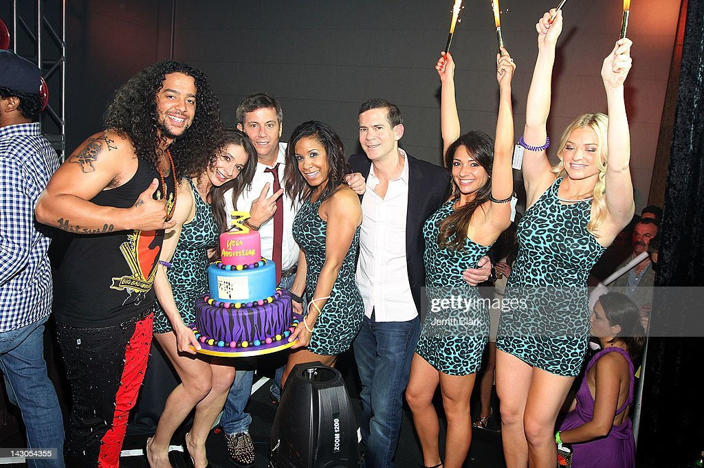 SkyBlu of LMFAO poses with the Barry Brothers and models at the 3 year anniversary party at The Chandelier Room in the W Hotel Hoboken on April 17, 2012 in Hoboken, New Jersey.