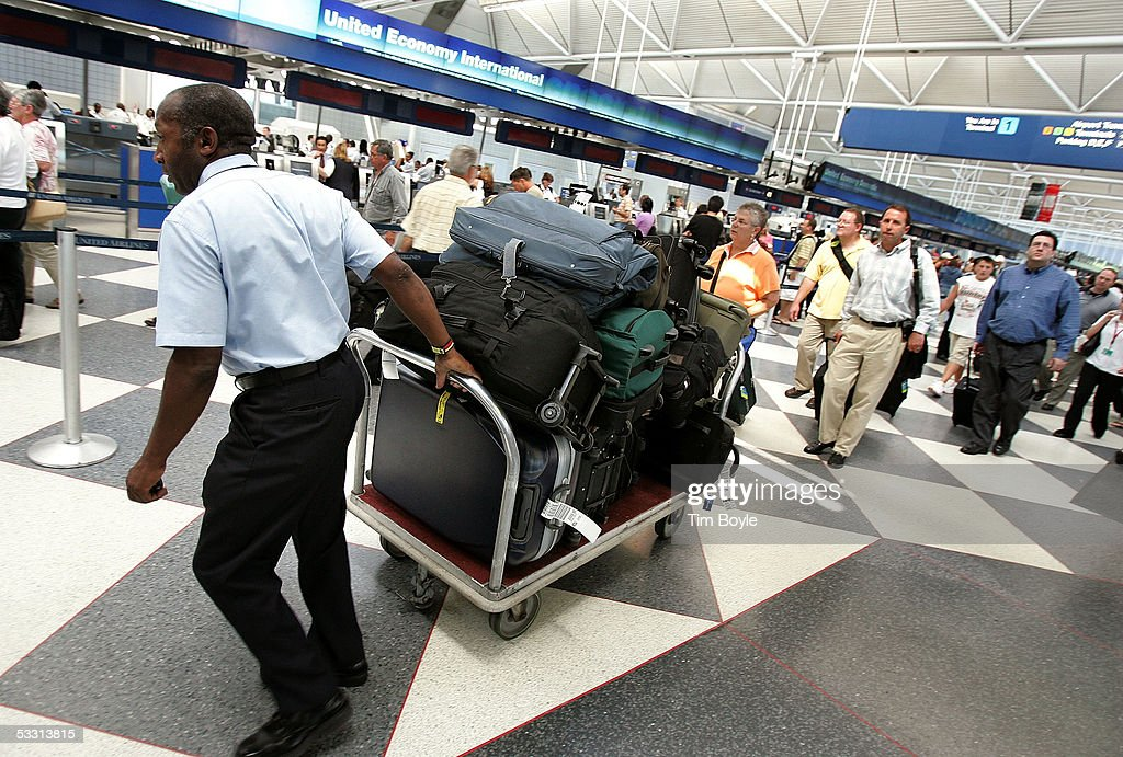 A skycap manager who did not want to be identified by name pulls a cart of baggage picked up curbside through the United Airlines terminal at O'Hare...