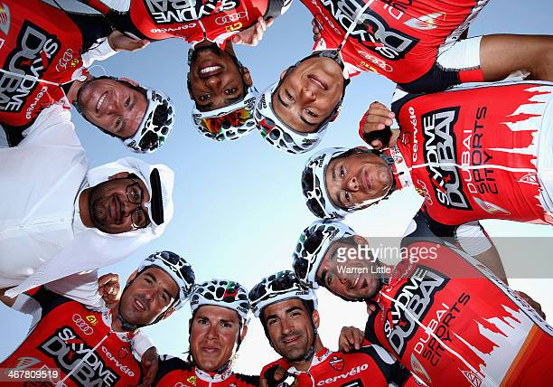 Skydive Dubai Pro Cycling Team pose for a picture with their manager Abdul Rahman Al Amri ahead of stage four of the 2014 Dubai Tour on February 8...