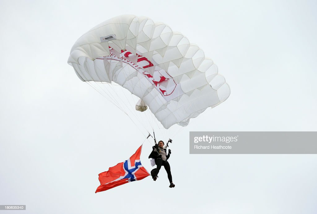 A Skydiver brings the Norwiegen national flag to the ceremony during the third round of The Evian Championship at the Evian Resort Golf Club on September 15, 2013 in Evian-les-Bains, France.