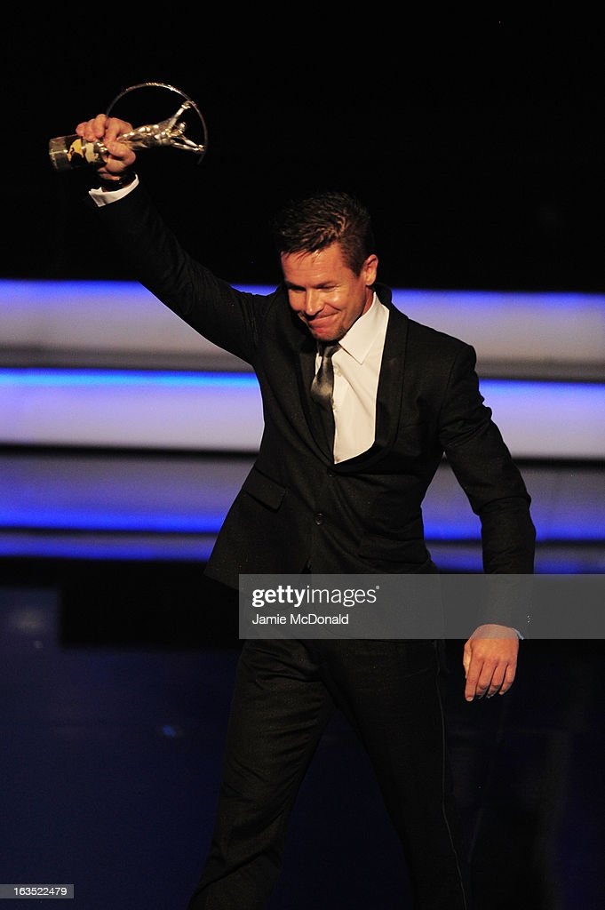 Skydiver Felix Baumgartner poses with his trophy for Laureus World Action Sportsperson of the Year on stage during the awards show for the 2013...