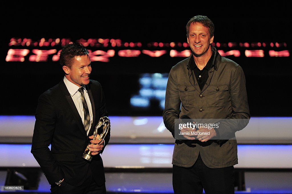Skydiver Felix Baumgartner recieves his trophy for Laureus World Action Sportsperson of the Year from Laureus Academy Member Tony Hawk on stage...