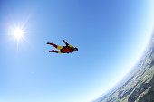 Skydiver free falling face down above Leutkirch, Bavaria, Germany