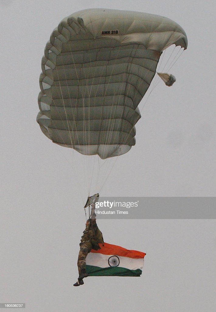A skydiver getting down during 'Army Equipment Display and Military Tattoo' at Army Polo Ground, Race Course on February 2, 2013 in Kolkata, India.