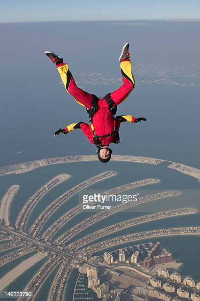 Skydiver 'head down flying' over the Dubai palm