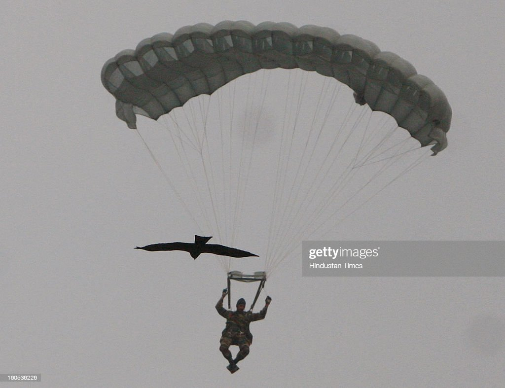 A skydiver is getting down during 'Army Equipment Display and Military Tattoo' at Army Polo Ground, Race Course on February 2, 2013 in Kolkata, India.