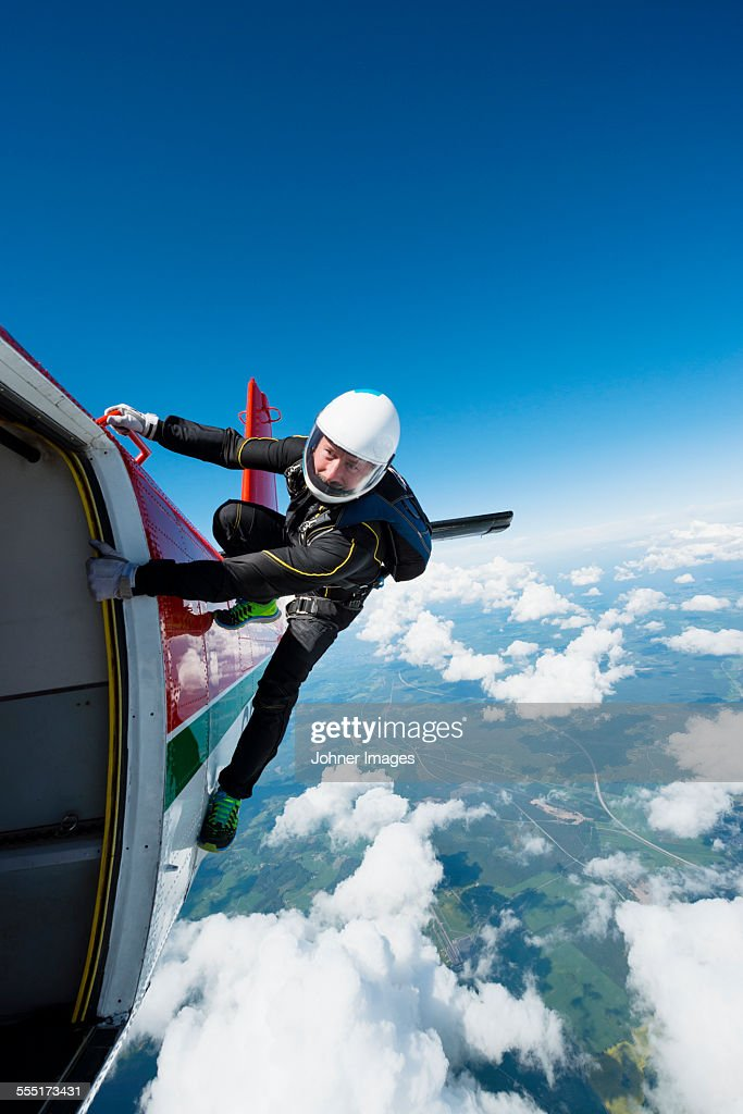 Sky-diver jumping from plane
