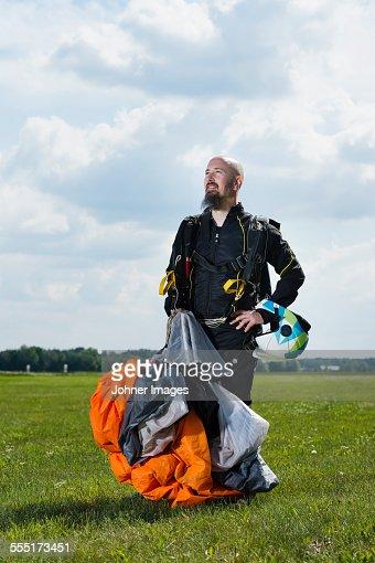Sky-diver on airport after safe landing