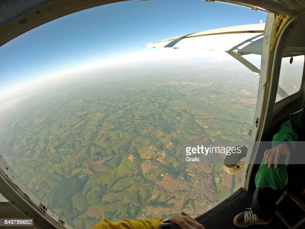 Skydiver point of view of the open door of the airplane.