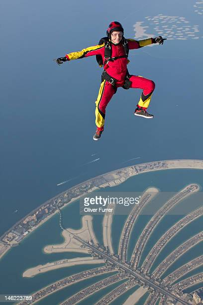 Skydiver sit flying over the Dubai palm islands